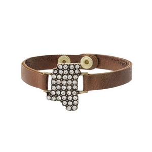 Bronze faux leather snap bracelet with the state shape of Mississippi, accented by clear rhinestones.