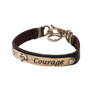 "Brown and gold tone faux leather bracelet stamped with ""Courage."""