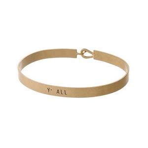 """Gold tone, brass bangle bracelet stamped with """"Y'all."""""""