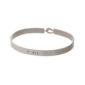"Silver tone, brass bangle bracelet stamped with ""Y'all."""