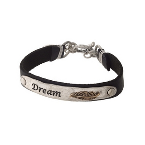 "Black and silver tone faux leather bracelet stamped with ""Dream."""