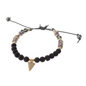 Brown waxed cord adjustable bracelet with black natural stone beads and a triangle charm. Handmade in the USA.