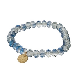 Blue iridescent faceted bead stretch bracelet with a hammered gold tone circle charm.