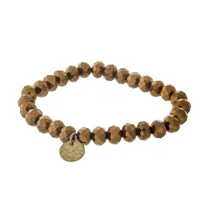 Bronze faceted bead stretch bracelet with a hammered gold tone circle charm.