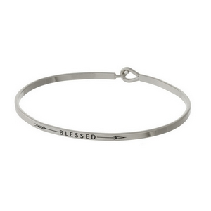 "Dainty silver tone bangle bracelet stamped with ""Blessed."""