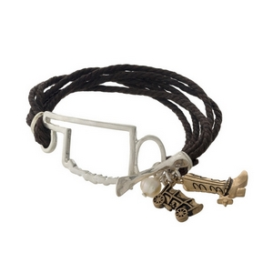 Brown braided cord bracelet with a silver tone shape of Oklahoma focal, gold tone charms, and a toggle closure.