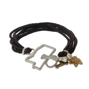 Brown braided cord bracelet with a silver tone shape of Mississippi focal, gold tone charms, and a toggle closure.