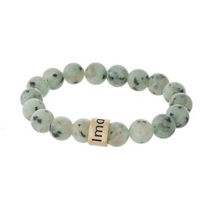 "Sesame jasper, natural stone beaded stretch bracelet with a gold tone bead, stamped with ""Imagine."""
