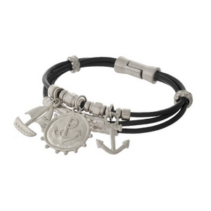 Brown leather magnetic bracelet with silver tone anchor, sailboat, and nautical charms.