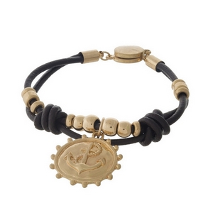 Brown leather magnetic bracelet with gold tone accents and an anchor charm.