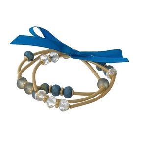 Three piece, gold tone, stretch bracelet set featuring teal and iridescent faceted beads.