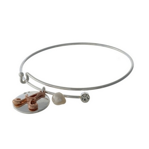 Silver tone adjustable bangle bracelet with a rose gold tone 'A' initial.