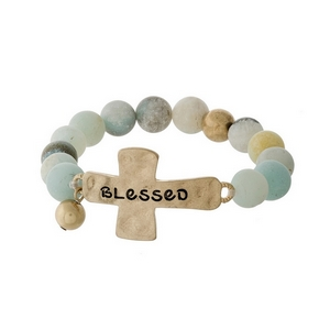 "Amazonite beaded stretch bracelet with a gold tone cross, stamped with ""Blessed."""