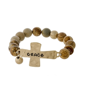 "Picture jasper beaded stretch bracelet with a gold tone cross, stamped with ""Grace."""