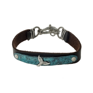 Brown faux leather bracelet with a patina and silver tone whale tail focal.