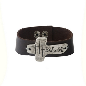 "Brown faux leather snap bracelet with a silver tone focal stamped with ""Believe."" Approximately 1"" in width."