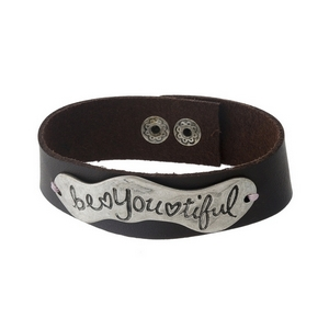 """Brown faux leather snap bracelet with a silver tone focal stamped with """"Be You Tiful."""" Approximately 1"""" in width."""