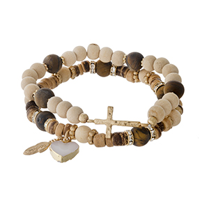 Two piece beaded stretch bracelet set with tiger's eye beads, a heart druzy charm and a gold tone cross.