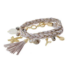 Light gray, braided faux suede wrap bracelet with a gold tone starfish and shell charm.