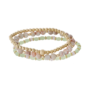 Three piece stretch bracelet set featuring gold tone, light pink natural stone, and light green faceted beads.
