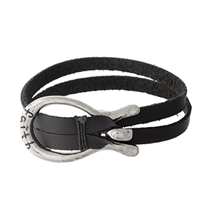 "Black faux leather bracelet with a silver tone hook closure stamped with ""Faith."""