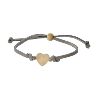 Gray faux suede, pull-tie bracelet with a gold tone heart shaped focal.