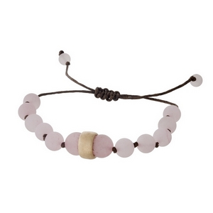 Brown cord bracelet with rose quartz natural stone beads, a gold tone bead accents and a pull-tie closure.