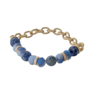 Matte gold tone stretch bracelet with sodalite natural stone beads and blue faceted beads.