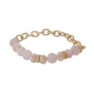 Matte gold tone stretch bracelet with rose quartz natural stone beads and peach faceted beads.