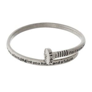 Silver tone bangle bracelet in the shape of a nail, stamped with Jeremiah 29:11.