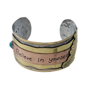 "Hammered silver cuff bracelet stamped with ""Believe in Yourself."""
