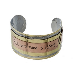 "Hammered silver cuff bracelet stamped with ""All you need is love."""