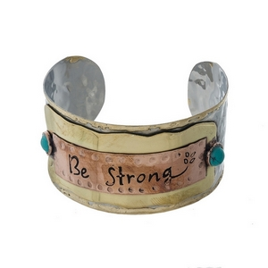 "Hammered silver tone cuff bracelet stamped with ""Be Strong."""
