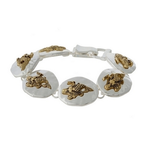 Silver tone magnetic bracelet featuring gold tone mermaids.
