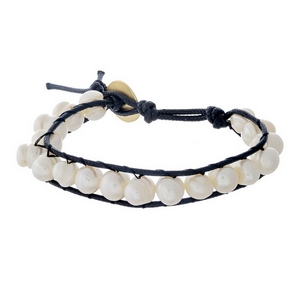 Black waxed cord bracelet featuring freshwater pearl beads and a button closure.