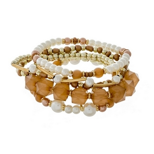 Gold tone stretch bracelet set featuring topaz, pearl and gold tone beads.