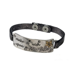 "Gunmetal gray, faux leather snap bracelet featuring a silver tone focal stamped with ""Make a wish upon a starfish."" Approximately 8"" in length."