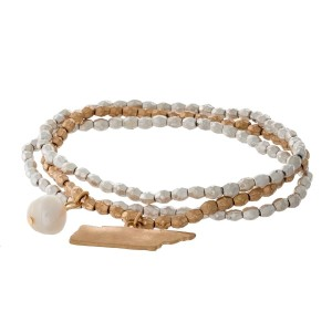 Two tone stretch bracelet with a state of Tennessee and freshwater pearl bead charm.