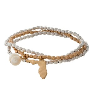 Two tone stretch bracelet with a state of Florida and freshwater pearl bead charm.