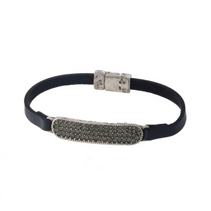 Black leather bracelet with a gray pave, silver tone bar and a magnetic closure.