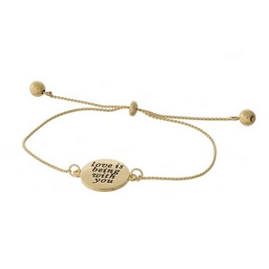 "Dainty gold tone pull-tie bracelet with two birds on one side and the other side is stamped with ""Love is being with you."""