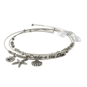"Three piece, silver tone bangle set featuring sea life charms and a bar stamped with ""Seize the Day."""