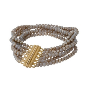 Gray and bronze beaded bracelet with multi strands and a gold tone magnetic closure.