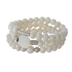 Three piece, freshwater pearl beaded stretch bracelet with silver tone accents.