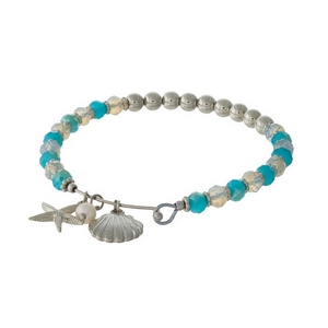 Turquoise and silver tone beaded bangle bracelet with sea life charms.