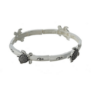 Silver tone stretch bracelet featuring turtle charms.