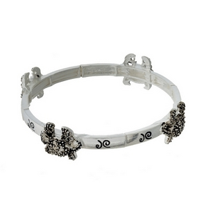 Silver tone stretch bracelet featuring crab charms.