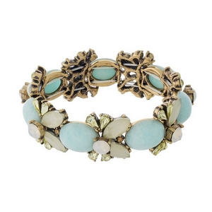 Gold tone stretch bracelet with mint green, yellow and opal stones and rhinestones.
