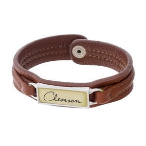 """Officially licensed, Clemson University brown faux leather snap bracelet with a silver tone bar saying """"Clemson."""""""