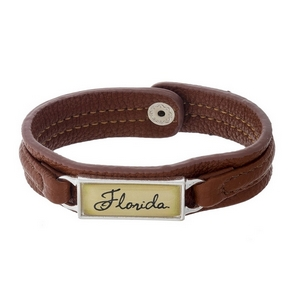 """Officially licensed, University of Florida brown faux leather snap bracelet with a silver tone bar saying """"Florida."""""""